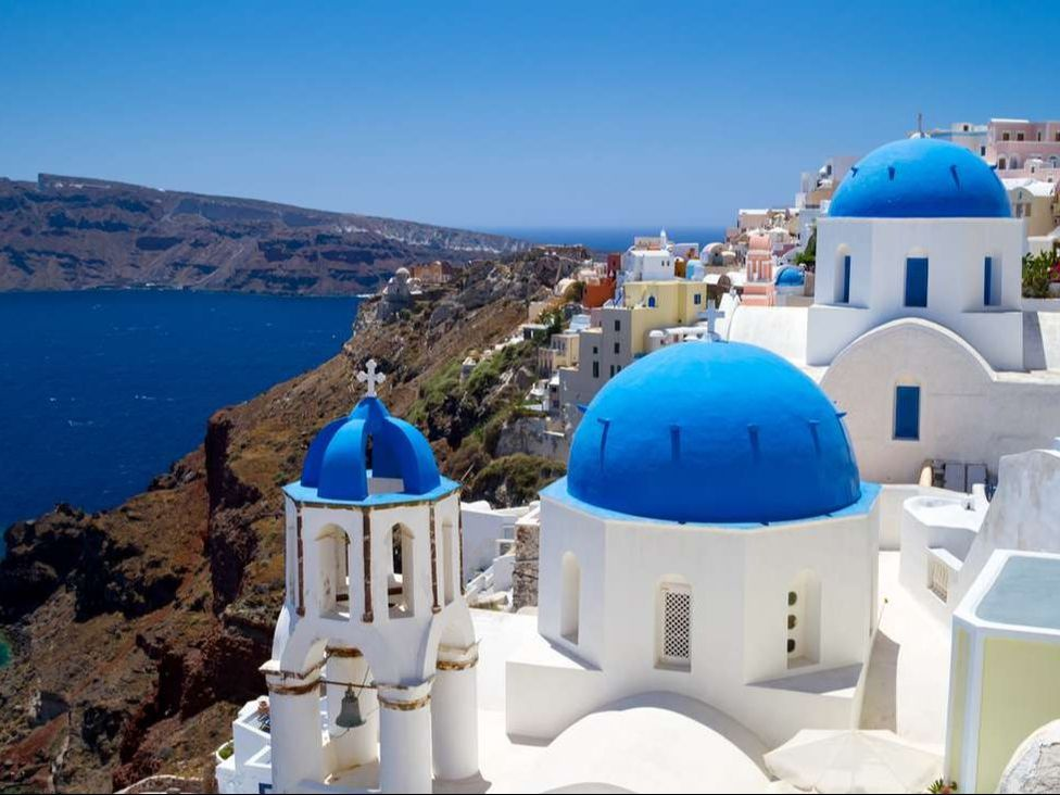 Blue churches of Oia village at Santorini island. Greece