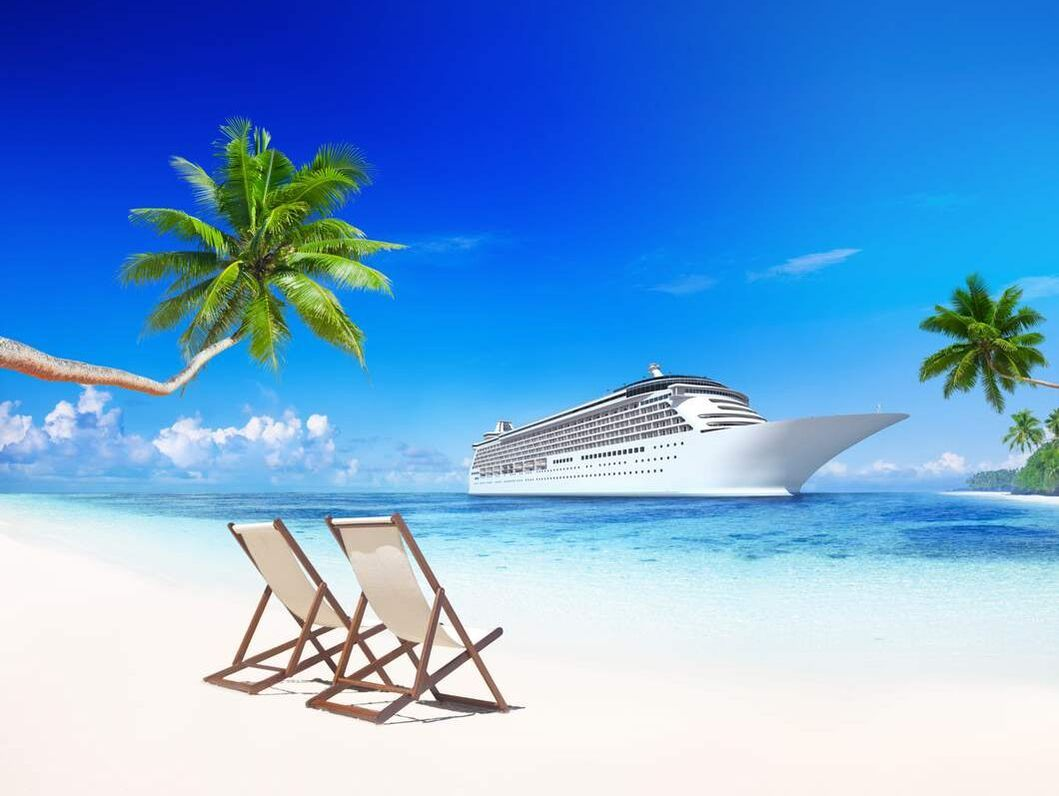 Cruise ship by tropical beach